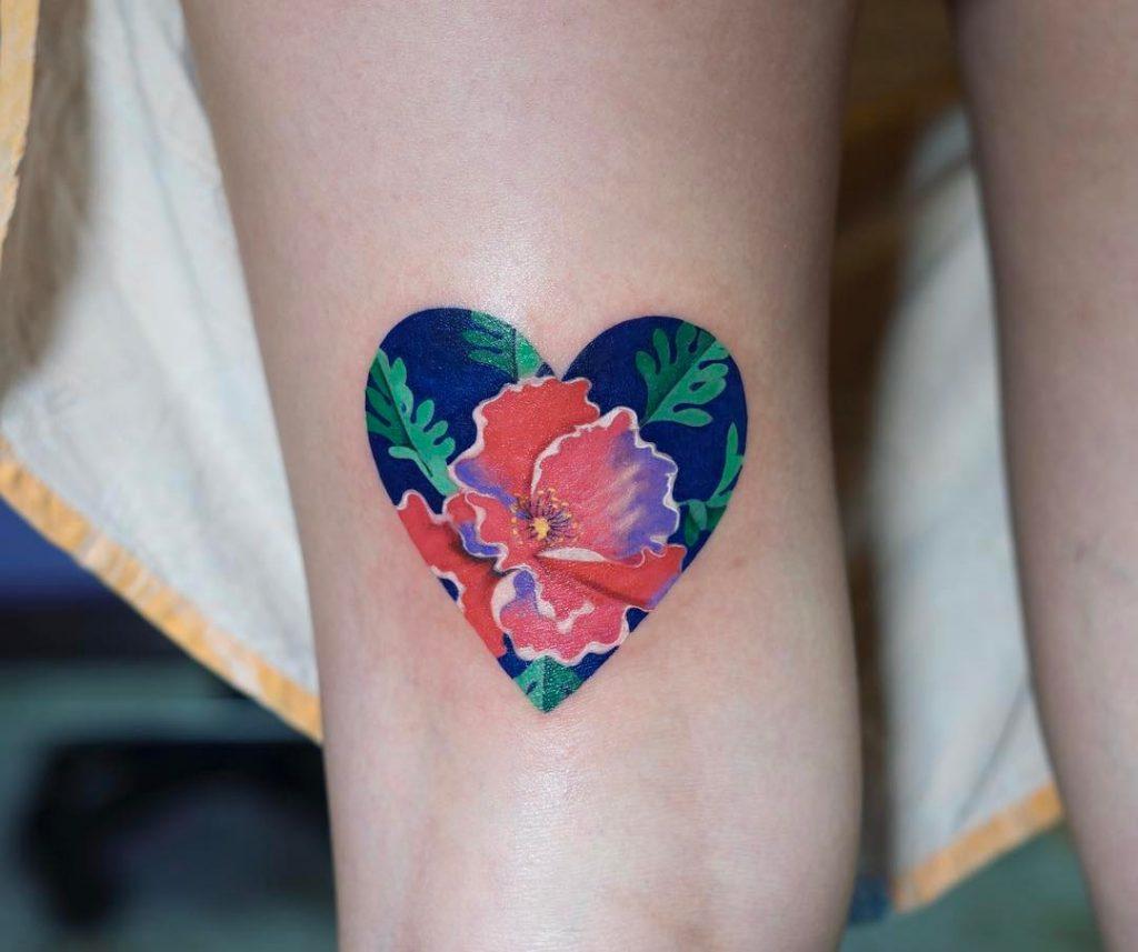 Flower in a heart tattoo