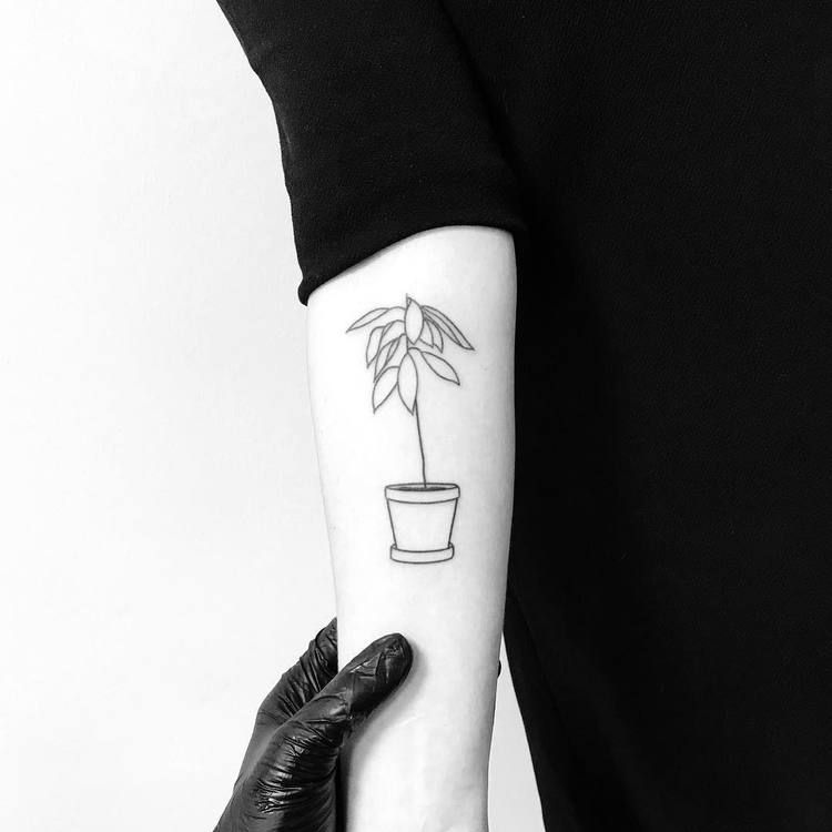 Flower in a pot minimalist style tattoo