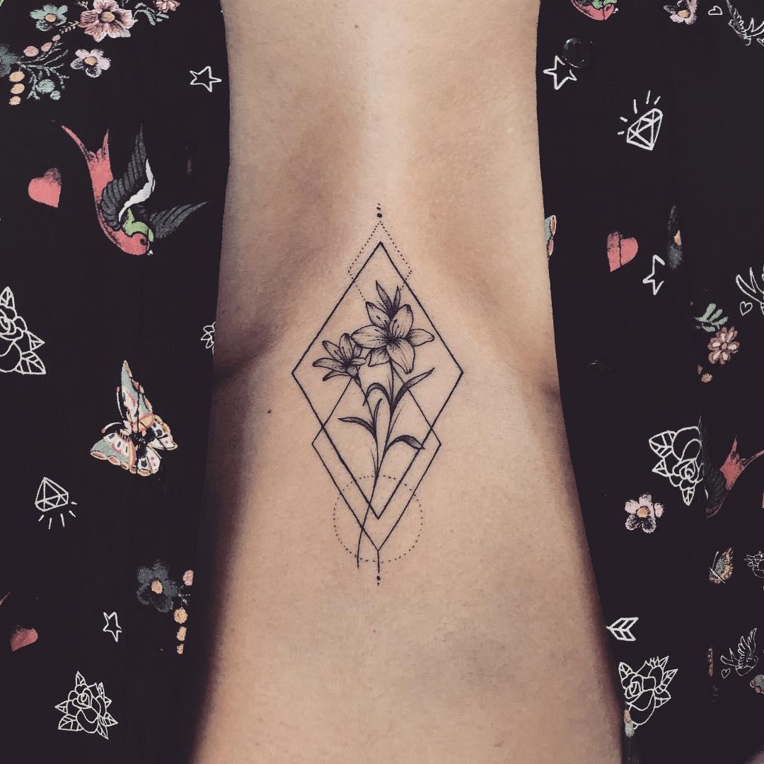 24f4eba22 Flower in a rhombus tattoo on the sternum - Tattoogrid.net