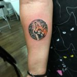 Fox in a circle tattoo