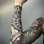 Full sleeve black pattern tattoo