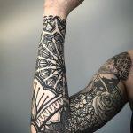 Full sleeve black pattern tattoo