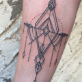 Geometric ornamental pattern tattoo