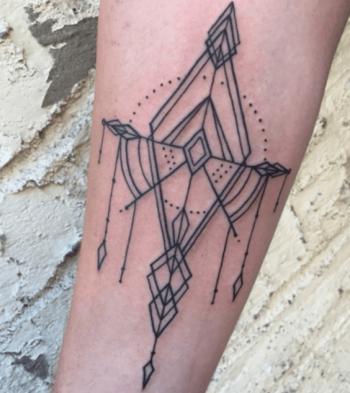 Geometric ornamental pattern tattoo