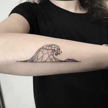 Geometric wave tattoo on the forearm