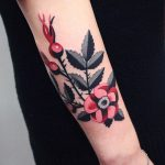 Gorgeous black grey and red flower tattoo