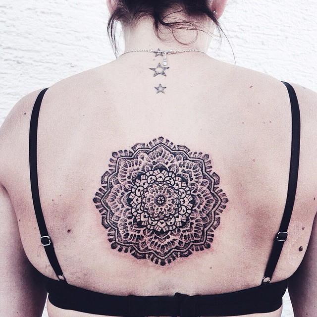 Gorgeous dotwork mandala tattoo on the back