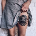 Gorgeous floral circle tattoo