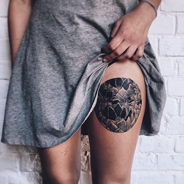 Gorgeous floral circle tattoo