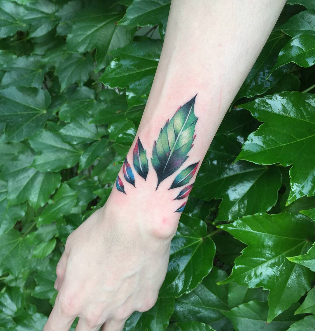 Gorgeous green leaves tattoo