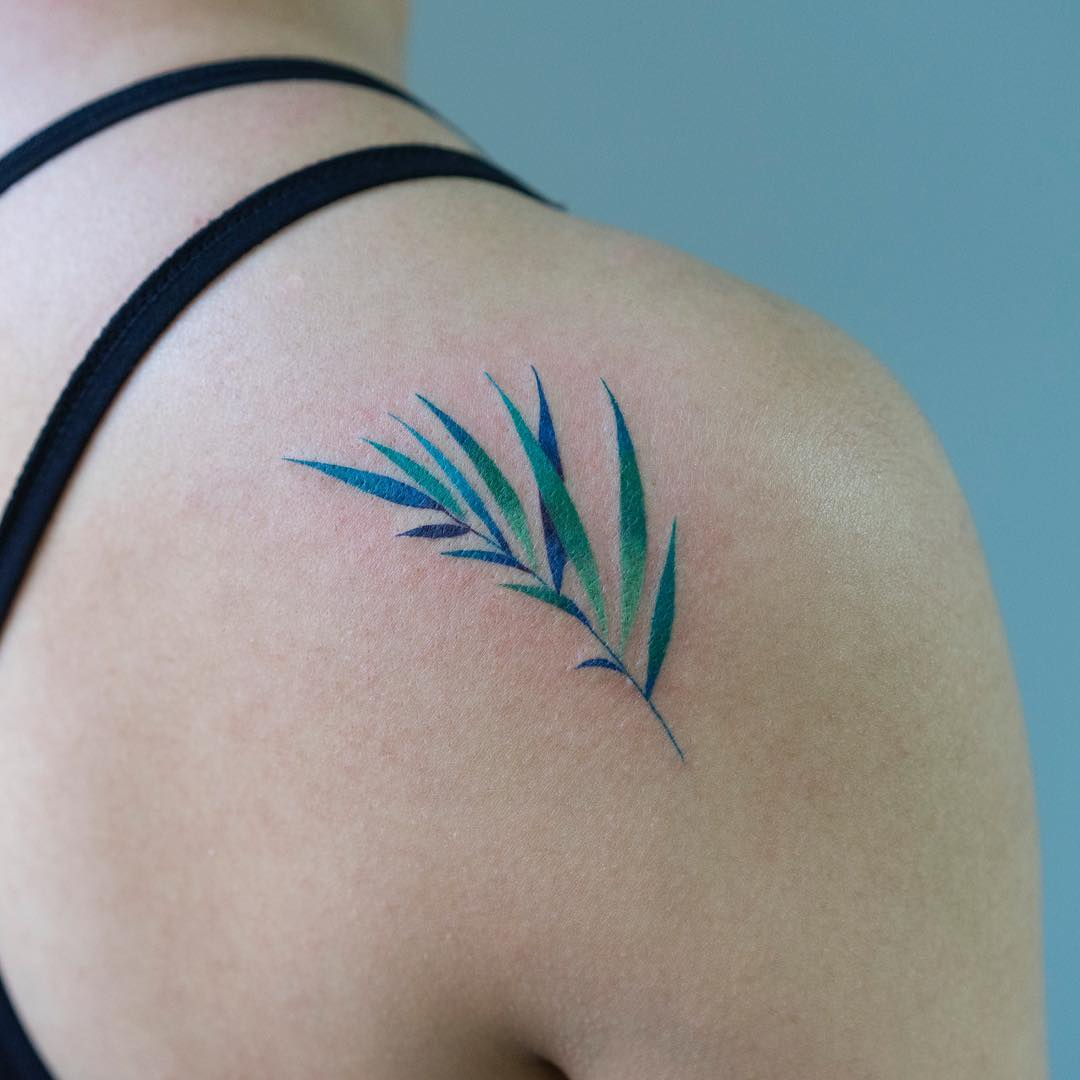 Green branch with leaves tattoo