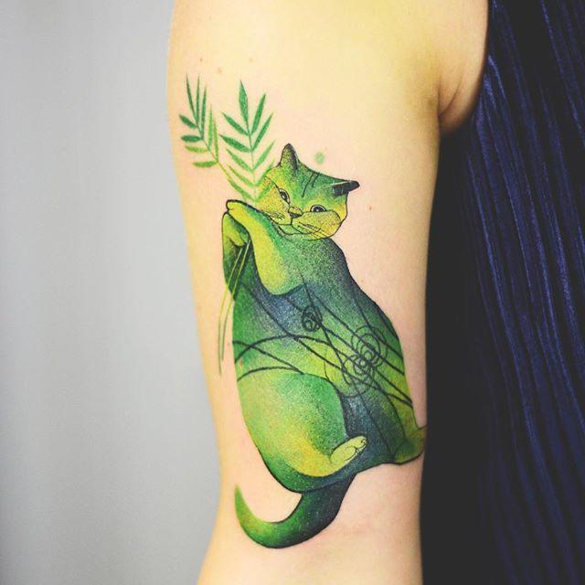 Green cat tattoo