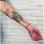 Green fern and other leaves tattoo