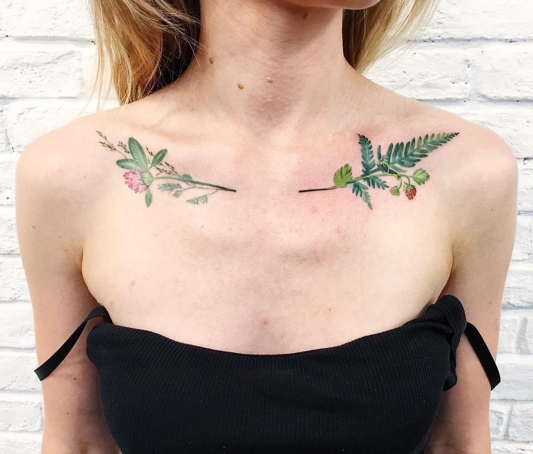 Green plant tattoos on collarbone