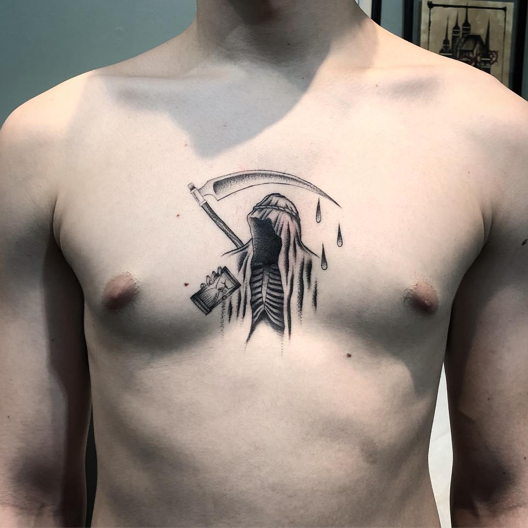 Grim reaper sternum tattoo