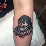 Grip reaper with a flower tattoo