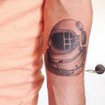 Hand poked astronaut helmet tattoo