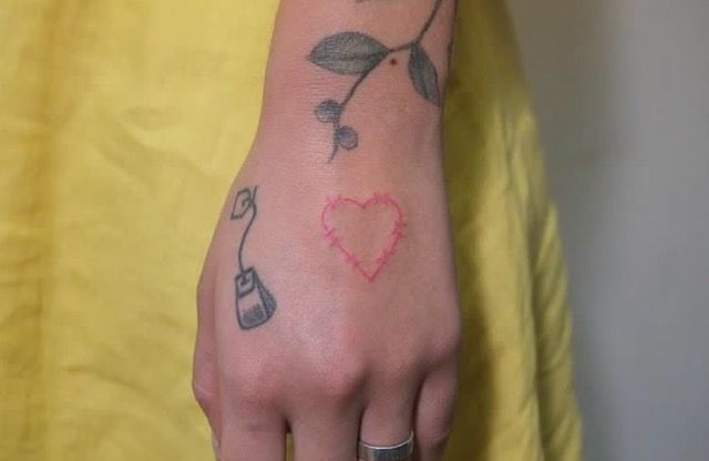 Heart shaped barbed wire tattoo