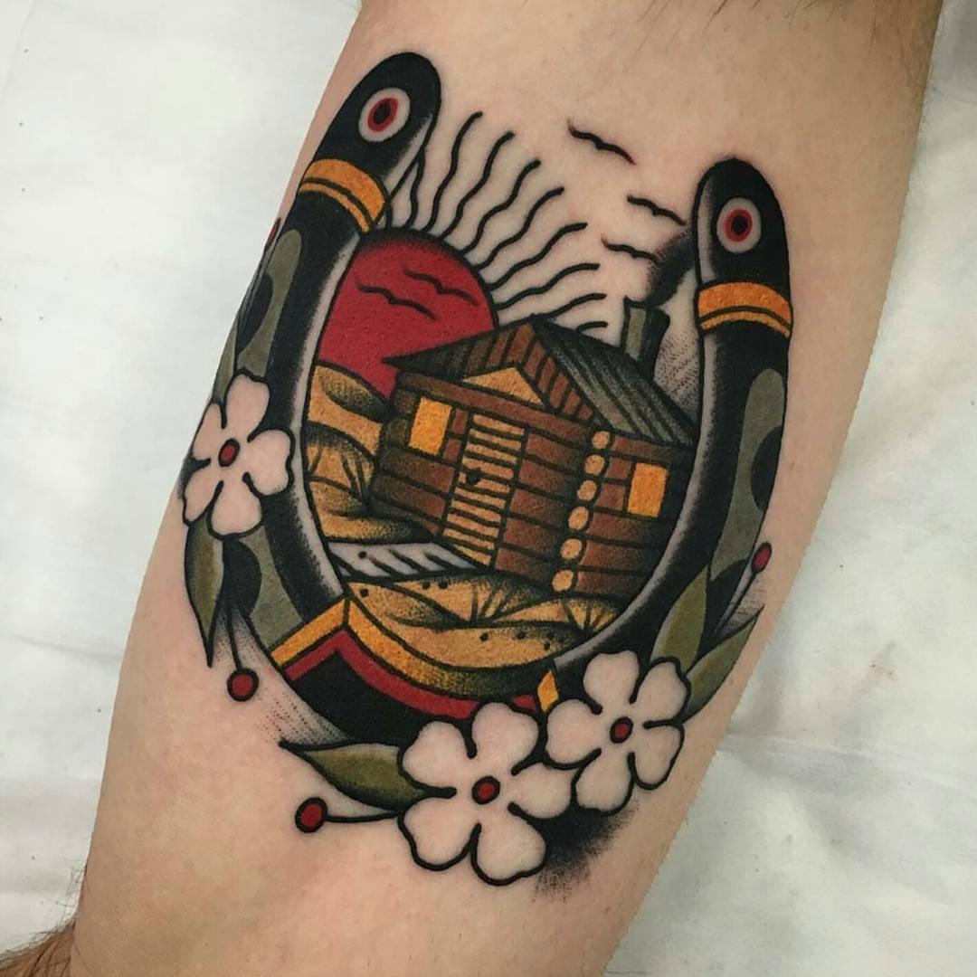 Horseshoe with a hut tattoo