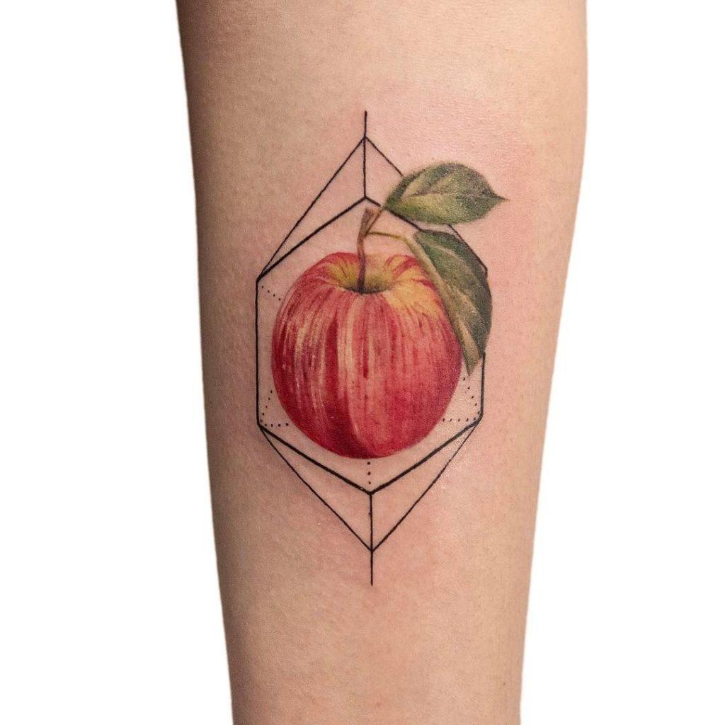 Hyper realistic apple tattoo