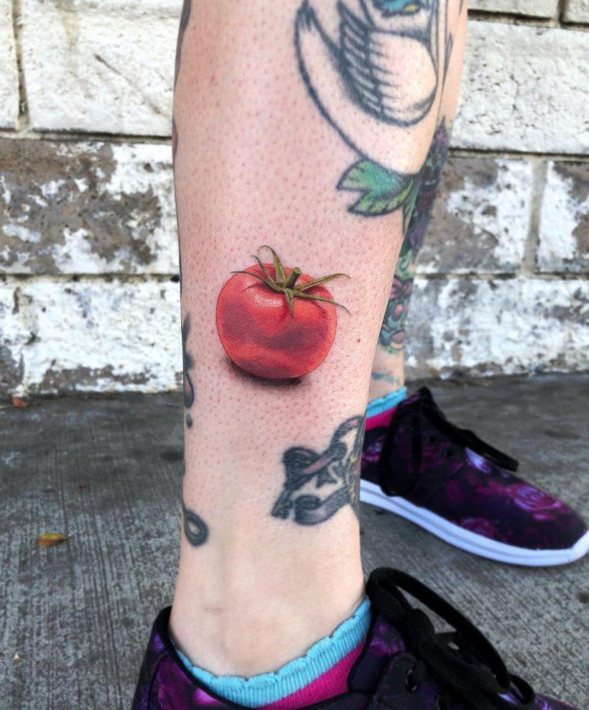 Hyper realistic tomato tattoo