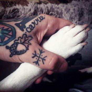 Icelandic stave tattoo on the thumb