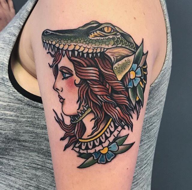Lady and aligator tattoo