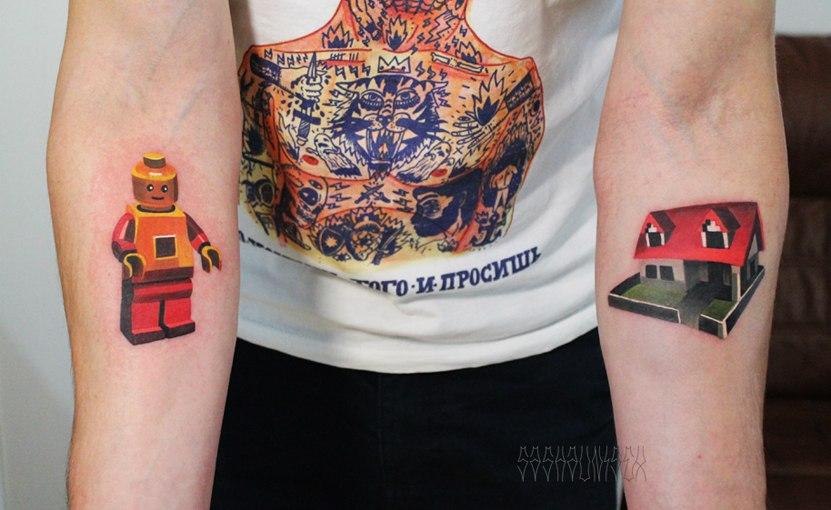 Lego mini figure and house tattoo