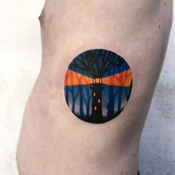 Lighthouse in a circle tattoo