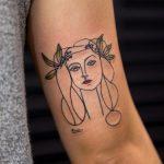 Linear face tattoo
