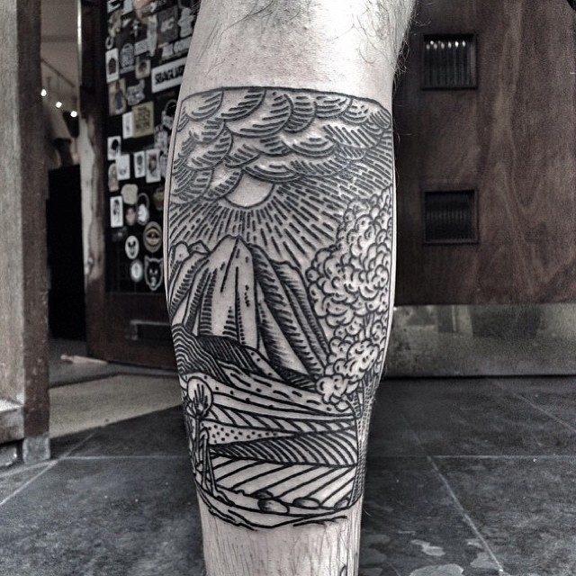 Linear landscape tattoo on the calf