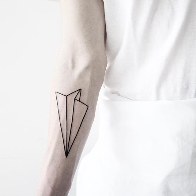 Linear paper airplane tattoo