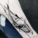 Linear whale tattoo