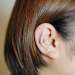 Little wildflower tattoo on the ear