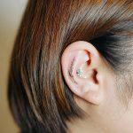 Little wildflower tattoo on the ear