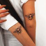 Matching bee tattoos