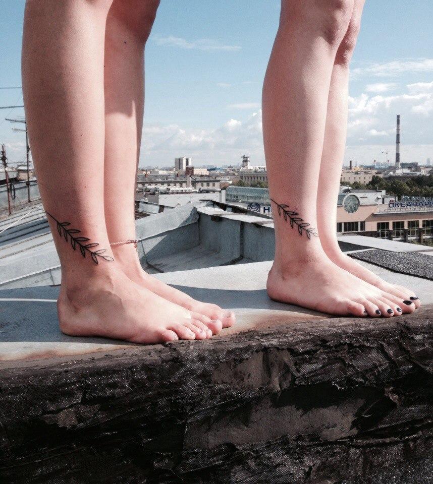 Matching branch tattoos