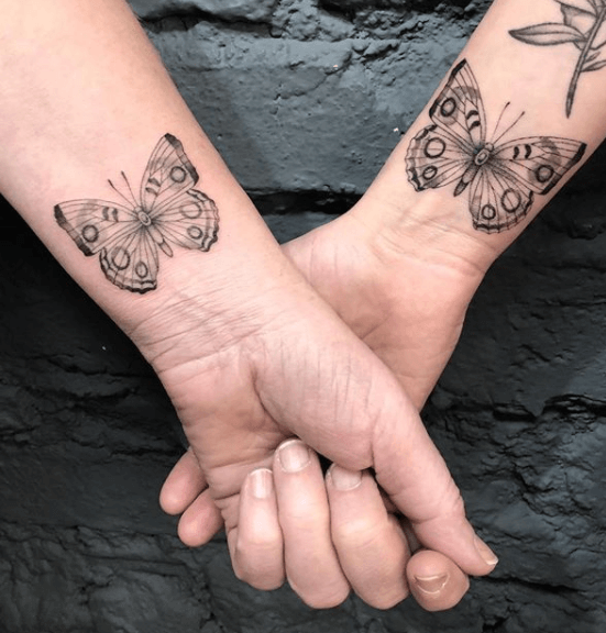 Matching butterfly tattoos on the wrists