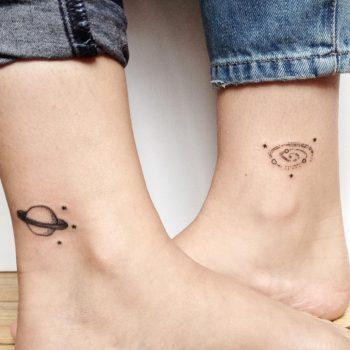 Matching saturn and spiral galaxy tattoo