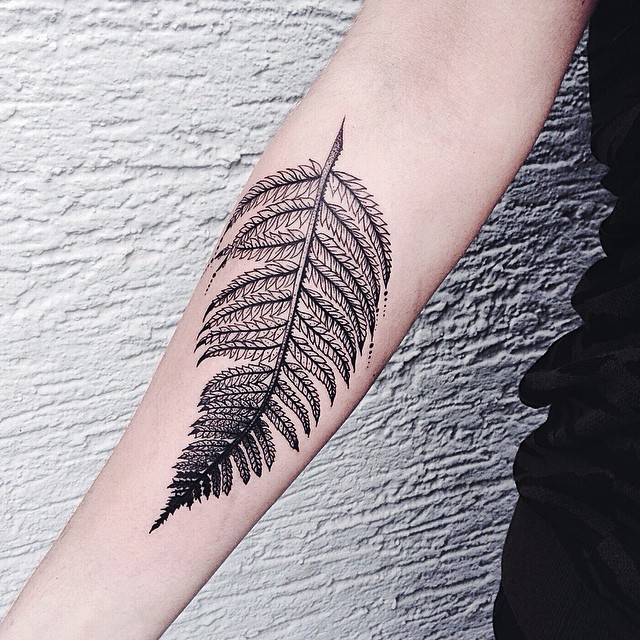 Monochrome black fern leaf tattoo