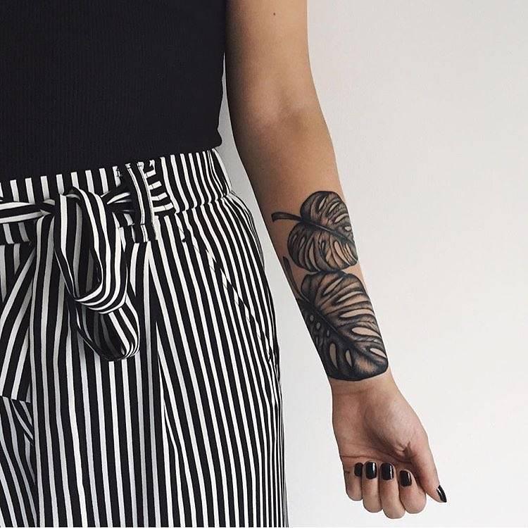 Monstera leaves tattoo on the inner forearm