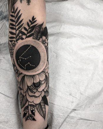 Negative space aquarius constellation tattoo