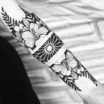 Negative space floral mandala and flowers tattoo