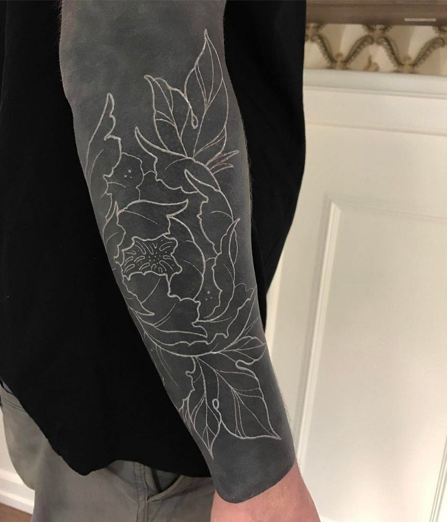 Negative space flower tattoo on the black background