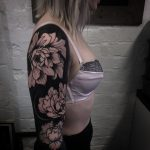 Negative space full sleeve flower tattoo