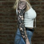 Negative space full sleeve rose tattoo
