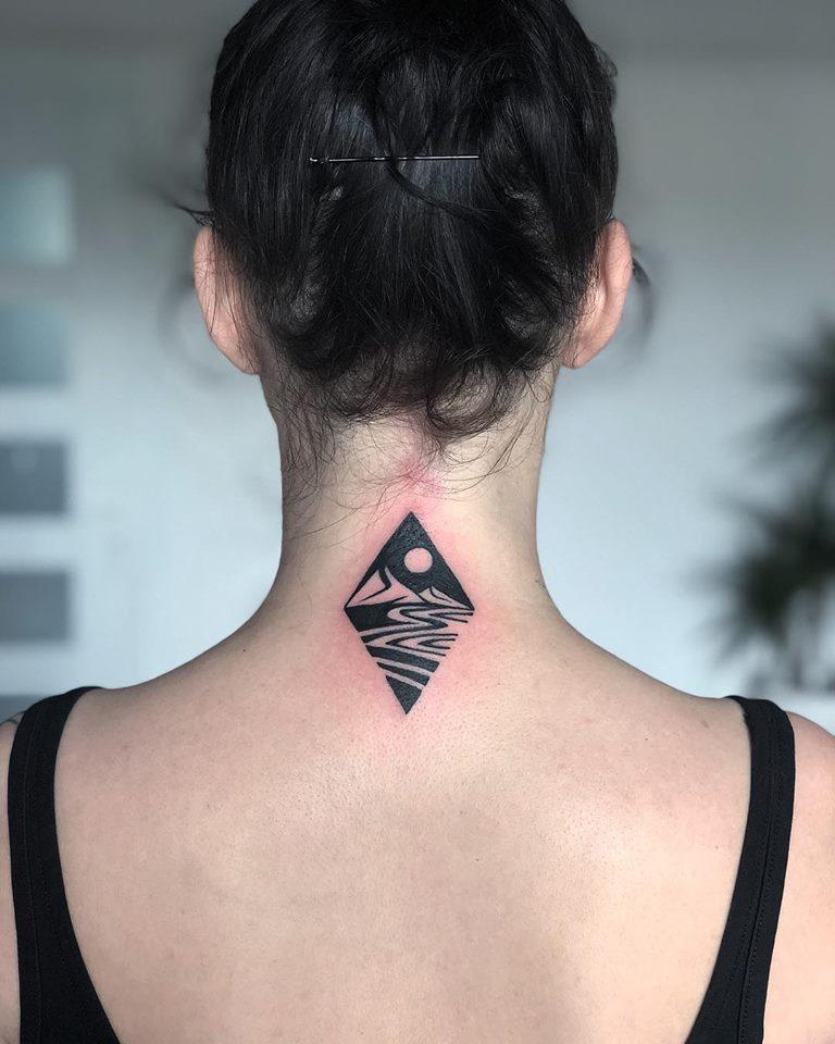 Negative space landscape rhombus tattoo