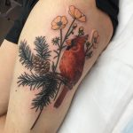Northern cardinal sitting on a branch tattoo