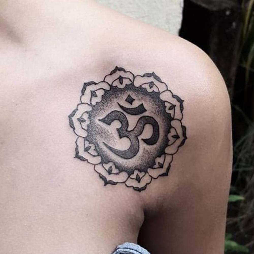 Om tattoo on the collarbone