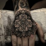Ornamental tattoo on the right hand